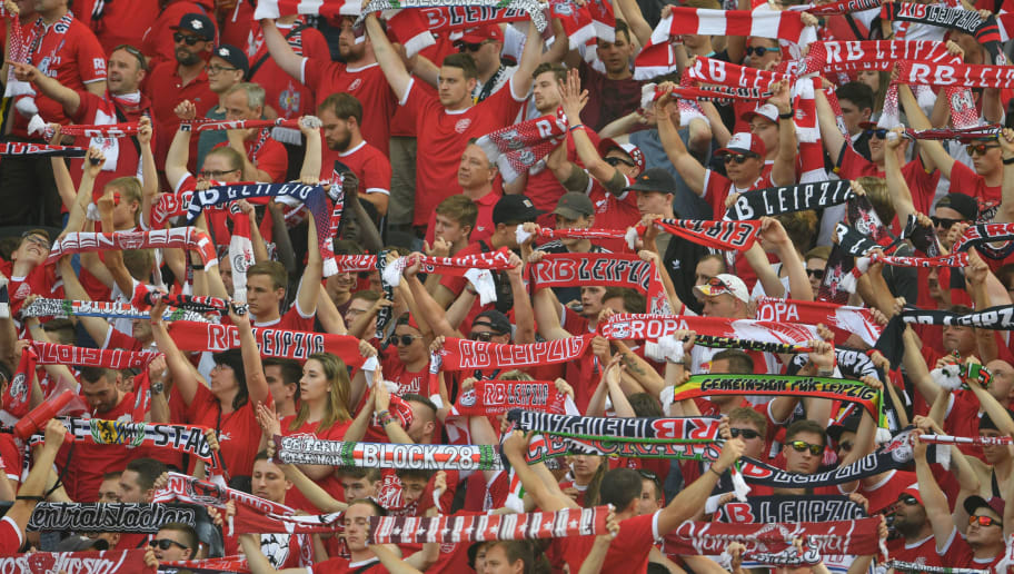 BERLIN, GERMANY - MAY 12: Supporters of Leipzig cheer their team during the Bundesliga match between Hertha BSC and RB Leipzig at Olympiastadion on May 12, 2018 in Berlin, Germany. (Photo by Thomas Starke/Bongarts/Getty Images)