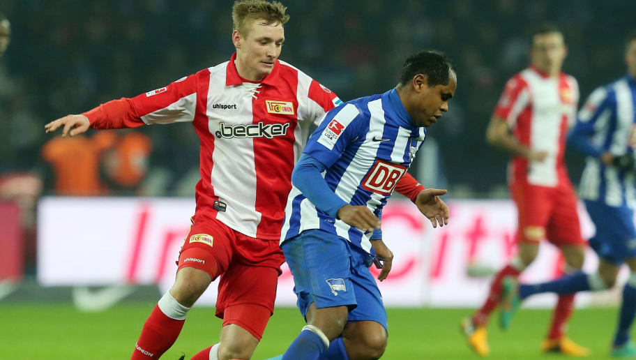 BERLIN, GERMANY - FEBRUARY 11:  Christoph Menz (L) of Union battles for the ball with Ronny (R) of Hertha during the Second Bundesliga match between Hertha BSC Berlin and 1.FC Union Berlin at Olympic Stadium on February 11, 2013 in Berlin, Germany.  (Photo by Matthias Kern/Bongarts/Getty Images)
