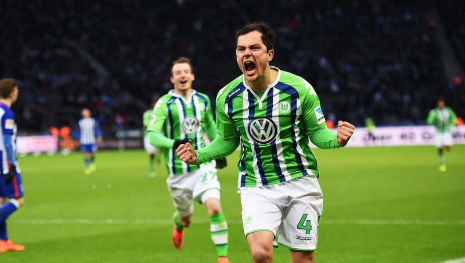BERLIN, GERMANY - FEBRUARY 20:  Marcel Schäfer of Wolfsburg celebrates scoring his goal during the Bundesliga match between Hertha BSC and VfL Wolfsburg at Olympiastadion on February 20, 2016 in Berlin, Germany.  (Photo by Stuart Franklin/Bongarts/Getty Images)