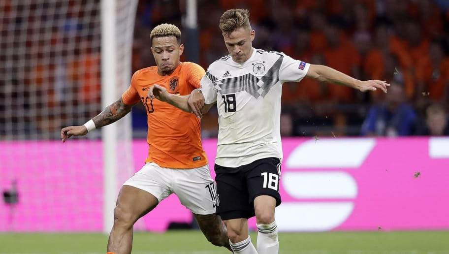 AMSTERDAM, NETHERLANDS - OCTOBER 13: (L-R) Memphis Depay of Holland, Joshua Kimmich of Germany  during the  UEFA Nations league match between Holland  v Germany  at the Johan Cruijff Arena on October 13, 2018 in amsterdam Netherlands (Photo by Cees van Hoogdalem/Soccrates /Getty Images)