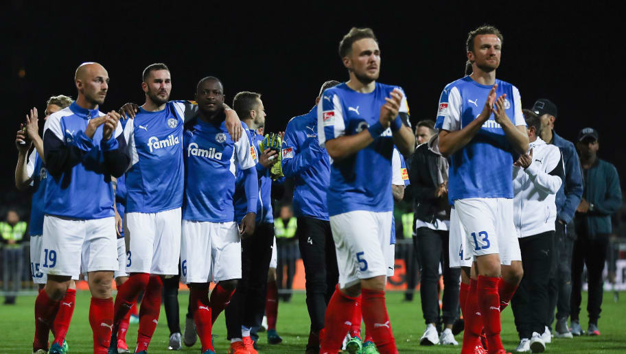 KIEL, GERMANY - MAY 21: Players of Kiel react after the Bundesliga Playoff Leg 2 match between Holstein Kiel and VfL Wolfsburg at Holstein-Stadion on May 21, 2018 in Kiel, Germany.  (Photo by Alex Grimm/Bongarts/Getty Images)