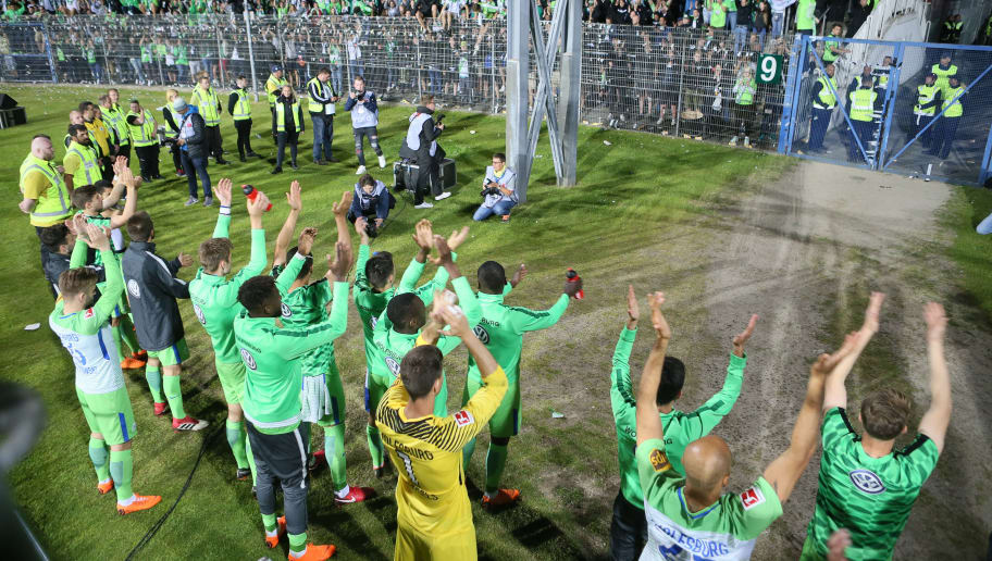 KIEL, GERMANY - MAY 21:  The team of VfL Wolfsburg celebrate their teams victory after the Bundesliga Playoff Leg 2 between Holstein Kiel and VfL Wolfsburg at Holstein-Stadion on May 21, 2018 in Kiel, Germany. (Photo by Selim Sudheimer/Bongarts/Getty Images)