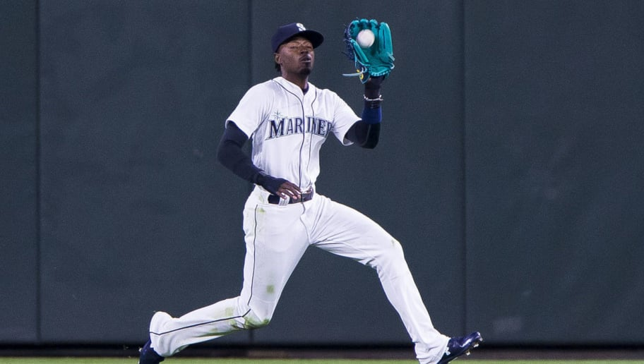 SEATTLE, WA - APRIL 16: Dee Gordon #9 of the Seattle Mariners gets the out on Marwin Gonzalez #9 of the Houston Astros in the second inning at Safeco Field on April 16, 2018 in Seattle, Washington. (Photo by Lindsey Wasson/Getty Images)