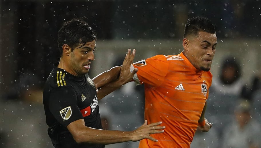 LOS ANGELES, CA - OCTOBER 12:  Darwin Ceren #24 of Houston Dynamo challenges Carlos Vela #10 of Los Angeles FC during the second half of the MLS match at Banc of California Stadium on October 12, 2018 in Los Angeles, California. Los Angeles FC defeated Houston Dynamo 4-2.  (Photo by Victor Decolongon/Getty Images)
