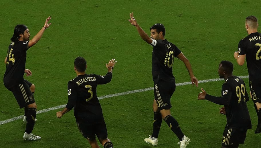 LOS ANGELES, CA - OCTOBER 12: Carlos Vela #10 of Los Angeles FC celebrates with teammates after converting a penalty kick during the first half of the MLS match against the Houston Dynamo at Banc of California Stadium on October 12, 2018 in Los Angeles, California.  (Photo by Victor Decolongon/Getty Images)