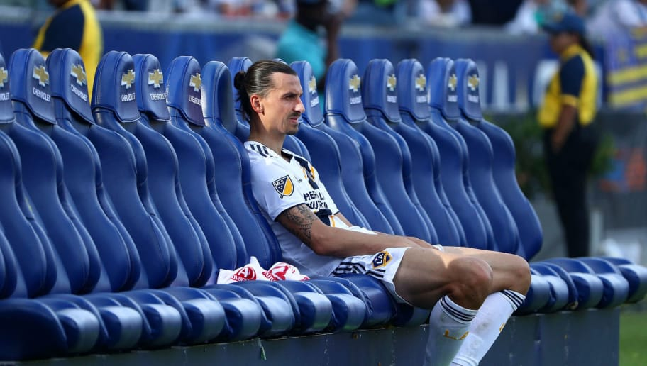 CARSON, CA - OCTOBER 28:  Zlatan Ibrahimovic #9 of Los Angeles Galaxy sits alone on the bench after their 3-2 loss to the Houston Dynamo in their MLS match at StubHub Center on October 28, 2018 in Carson, California. The Galaxy loss leaves them out of this year's playoffs.  (Photo by Victor Decolongon/Getty Images)