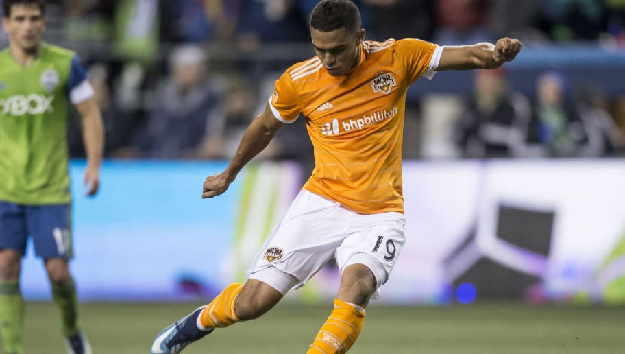 SEATTLE, WA - NOVEMBER 30: Mauro Manotas #19 of the Houston Dynamo takes a shot during of the second leg of the MLS Western Conference Finals against the Seattle Sounders at CenturyLink Field on November 30, 2017 in Seattle, Washington. The Sounders won the match 3-0 and aggregate score 5-0 to advance to the MLS Cup for a second consecutive year. (Photo by Stephen Brashear/Getty Images)