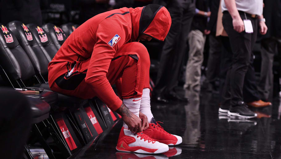 NEW YORK, NY - NOVEMBER 02: Carmelo Anthony #7 of the Houston Rockets laces his sneakers before the game against the Brooklyn Nets at Barclays Center on November 02, 2018 in the Brooklyn borough of New York City. NOTE TO USER: User expressly acknowledges and agrees that, by downloading and or using this photograph, User is consenting to the terms and conditions of the Getty Images License Agreement. (Photo by Matteo Marchi/Getty Images)