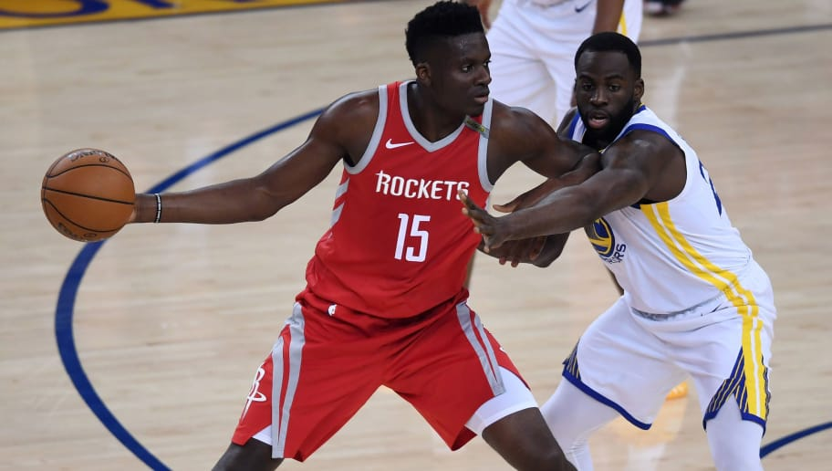 OAKLAND, CA - MAY 26:  Clint Capela #15 of the Houston Rockets looks to pass against Draymond Green #23 of the Golden State Warriors during Game Six of the Western Conference Finals in the 2018 NBA Playoffs at ORACLE Arena on May 26, 2018 in Oakland, California. NOTE TO USER: User expressly acknowledges and agrees that, by downloading and or using this photograph, User is consenting to the terms and conditions of the Getty Images License Agreement.  (Photo by Thearon W. Henderson/Getty Images)