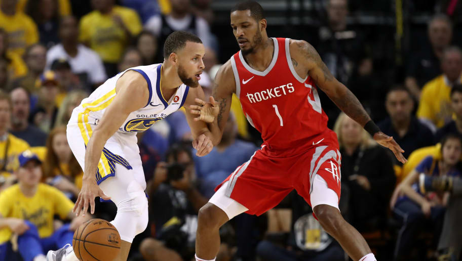 OAKLAND, CA - MAY 20:  Stephen Curry #30 of the Golden State Warriors controls the ball against Trevor Ariza #1 of the Houston Rockets during Game Three of the Western Conference Finals of the 2018 NBA Playoffs at ORACLE Arena on May 20, 2018 in Oakland, California. NOTE TO USER: User expressly acknowledges and agrees that, by downloading and or using this photograph, User is consenting to the terms and conditions of the Getty Images License Agreement.  (Photo by Ezra Shaw/Getty Images)