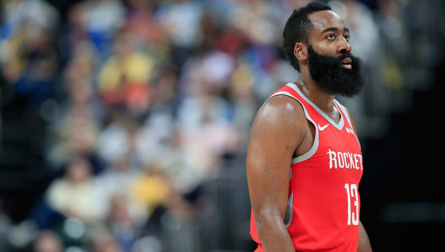 INDIANAPOLIS, IN - NOVEMBER 05:  James Harden #13 of the Houston Rockets watches the action against the Indiana Pacers at Bankers Life Fieldhouse on November 5, 2018 in Indianapolis, Indiana.  NOTE TO USER: User expressly acknowledges and agrees that, by downloading and or using this photograph, User is consenting to the terms and conditions of the Getty Images License Agreement.  (Photo by Andy Lyons/Getty Images)