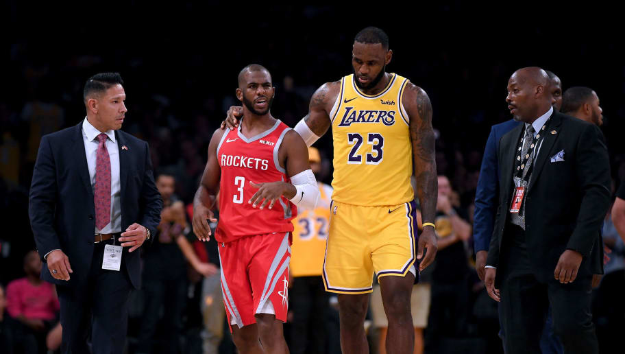 LOS ANGELES, CA - OCTOBER 20:  LeBron James #23 of the Los Angeles Lakers escorts Chris Paul #3 of the Houston Rockets after a fight involving Rajon Rondo #9 and Brandon Ingram #14 during a 124-115 Rockets win at Staples Center on October 20, 2018 in Los Angeles, California.  (Photo by Harry How/Getty Images)