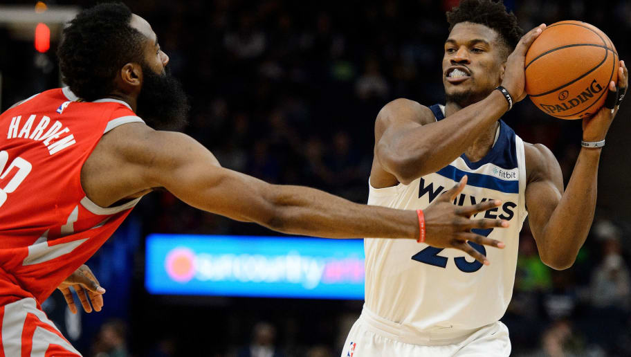 MINNEAPOLIS, MN - FEBRUARY 13: Jimmy Butler #23 of the Minnesota Timberwolves passes the ball away from James Harden #13 of the Houston Rockets during the game on February 13, 2018 at the Target Center in Minneapolis, Minnesota. NOTE TO USER: User expressly acknowledges and agrees that, by downloading and or using this Photograph, user is consenting to the terms and conditions of the Getty Images License Agreement. (Photo by Hannah Foslien/Getty Images)