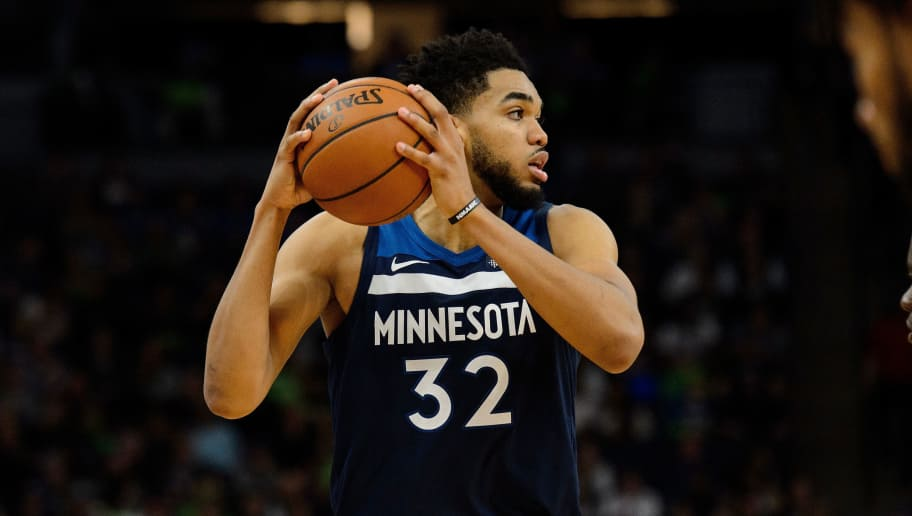 MINNEAPOLIS, MN - APRIL 23: Karl-Anthony Towns #32 of the Minnesota Timberwolves has the ball against the Houston Rockets in Game Four of Round One of the 2018 NBA Playoffs on April 23, 2018 at the Target Center in Minneapolis, Minnesota. The Rockets defeated the Timberwolves 119-100. NOTE TO USER: User expressly acknowledges and agrees that, by downloading and or using this Photograph, user is consenting to the terms and conditions of the Getty Images License Agreement. (Photo by Hannah Foslien/Getty Images)