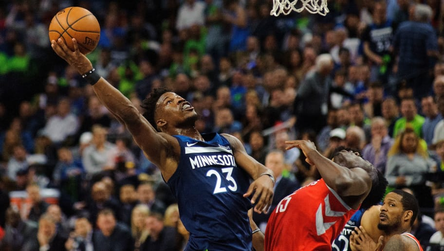 MINNEAPOLIS, MN - APRIL 23: Jimmy Butler #23 of the Minnesota Timberwolves shoots the ball against Clint Capela #15 of the Houston Rockets during the game in Game Four of Round One of the 2018 NBA Playoffs on April 23, 2018 at the Target Center in Minneapolis, Minnesota. The Rockets defeated the Timberwolves 119-100. NOTE TO USER: User expressly acknowledges and agrees that, by downloading and or using this Photograph, user is consenting to the terms and conditions of the Getty Images License Agreement. (Photo by Hannah Foslien/Getty Images)