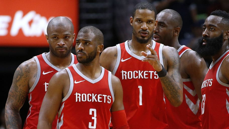 NEW ORLEANS, LA - MARCH 17:  Chris Paul #3 of the Houston Rockets, James Harden #13, Trevor Ariza #1, Luc Mbah a Moute #12 and PJ Tucker #4 talk during the second half against the New Orleans Pelicans at the Smoothie King Center on March 17, 2018 in New Orleans, Louisiana. NOTE TO USER: User expressly acknowledges and agrees that, by downloading and or using this photograph, User is consenting to the terms and conditions of the Getty Images License Agreement.  (Photo by Jonathan Bachman/Getty Images)