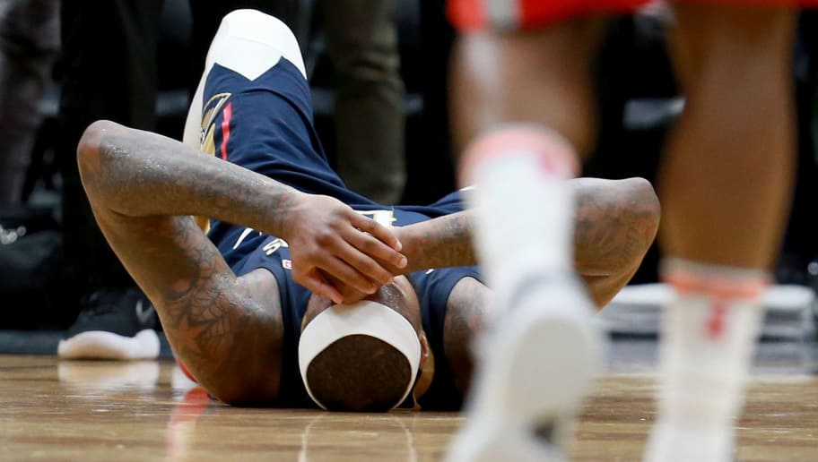 NEW ORLEANS, LA - JANUARY 26:  DeMarcus Cousins #0 of the New Orleans Pelicans lies down on the ground after injuring his ankle during the second half of a NBA game against the Houston Rockets at the Smoothie King Center on January 26, 2018 in New Orleans, Louisiana. NOTE TO USER: User expressly acknowledges and agrees that, by downloading and or using this photograph, User is consenting to the terms and conditions of the Getty Images License Agreement.  (Photo by Sean Gardner/Getty Images)