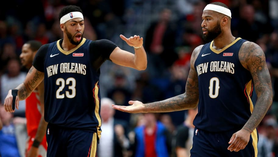 NEW ORLEANS, LA - JANUARY 26:  Anthony Davis #23 of the New Orleans Pelicans and DeMarcus Cousins #0 of the New Orleans Pelicans react after scoring against the Houston Rockets during a NBA game at the Smoothie King Center on January 26, 2018 in New Orleans, Louisiana. NOTE TO USER: User expressly acknowledges and agrees that, by downloading and or using this photograph, User is consenting to the terms and conditions of the Getty Images License Agreement.  (Photo by Sean Gardner/Getty Images)