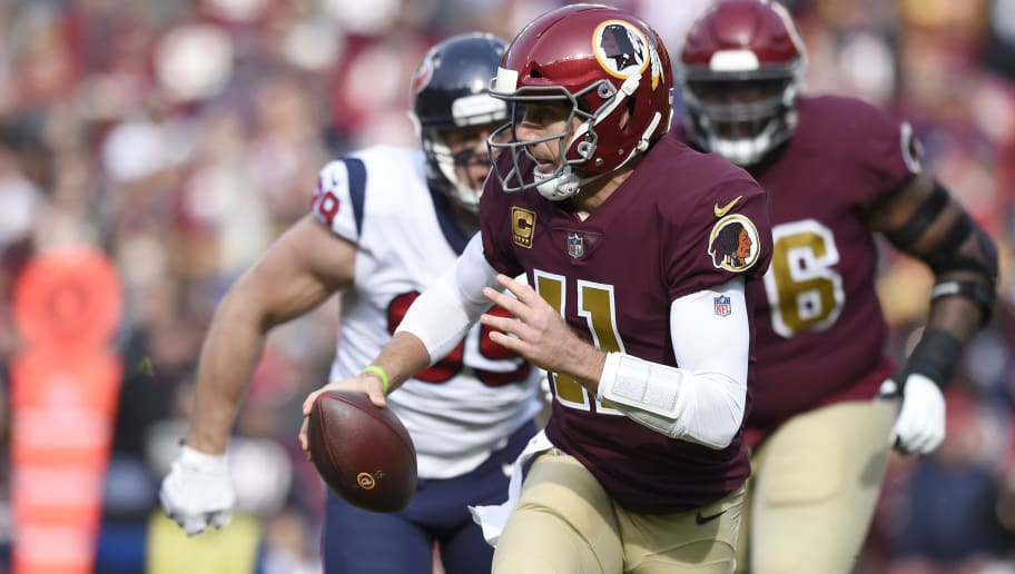 LANDOVER, MD - NOVEMBER 18: Alex Smith #11 of the Washington Redskins scrambles with the ball in the first quarter against the Houston Texans at FedExField on November 18, 2018 in Landover, Maryland. (Photo by Patrick McDermott/Getty Images)