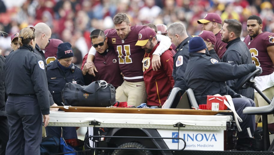 LANDOVER, MD - NOVEMBER 18: Alex Smith #11 of the Washington Redskins is helped off the field after being sacked and injured by Kareem Jackson #25 of the Houston Texans in the third quarter of the game at FedExField on November 18, 2018 in Landover, Maryland. (Photo by Joe Robbins/Getty Images)