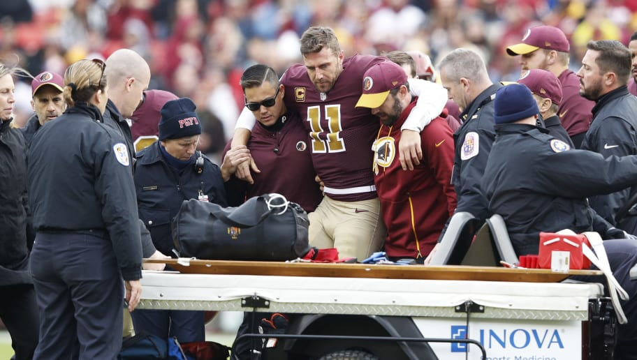 LANDOVER, MD - NOVEMBER 18: Alex Smith #11 of the Washington Redskins is helped off the field after suffering a devastating leg injury during the game against the Houston Texans at FedExField on November 18, 2018 in Landover, Maryland. The Texans won 23-21. (Photo by Joe Robbins/Getty Images)
