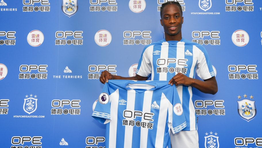 HUDDERSFIELD, ENGLAND - JUNE 08: New signing Terence Kongolo joins Huddersfield Town from AC Monaco and launches the new Umbro home kit on June 8, 2018 in Huddersfield, England. (Photo by John Early/Getty Images)