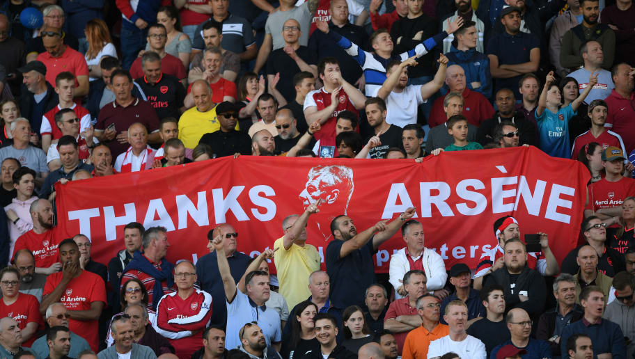 HUDDERSFIELD, ENGLAND - MAY 13:  Fans hold up signs celebrating Arsene Wenger after the Premier League match between Huddersfield Town and Arsenal at John Smith's Stadium on May 13, 2018 in Huddersfield, England.  (Photo by Shaun Botterill/Getty Images)