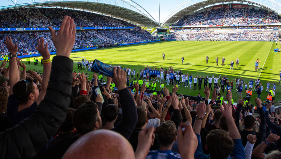 HUDDERSFIELD, ENGLAND - MAY 13: A general view of The John Smiths Stadium, home stadium of Huddersfield Town as Huddersfield Town players and staff celebrate with the fans at full time during the Premier League match between Huddersfield Town and Arsenal at John Smith's Stadium on May 13, 2018 in Huddersfield, England. (Photo by Robbie Jay Barratt - AMA/Getty Images)