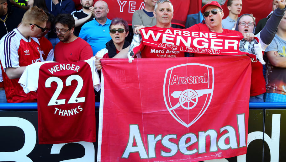 HUDDERSFIELD, ENGLAND - MAY 13: Arsenal fans display an Arsene Wenger shirt during the Premier League match between Huddersfield Town and Arsenal at John Smith's Stadium on May 13, 2018 in Huddersfield, England. (Photo by Chris Brunskill Ltd/Getty Images)