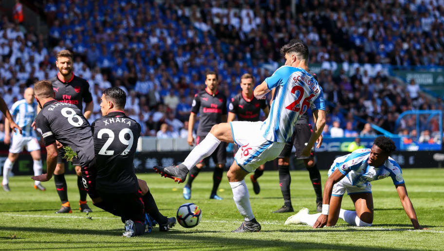 HUDDERSFIELD, ENGLAND - MAY 13: Granit Xhaka of Arsenal and Christopher Schindler of Huddersfield Town during the Premier League match between Huddersfield Town and Arsenal at John Smith's Stadium on May 13, 2018 in Huddersfield, England. (Photo by Robbie Jay Barratt - AMA/Getty Images)
