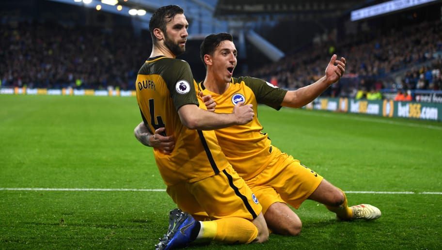 HUDDERSFIELD, ENGLAND - DECEMBER 01:  Shane Duffy of Brighton and Hove Albion celebrates with teammate Lewis Dunk after scoring his team's first goal during the Premier League match between Huddersfield Town and Brighton & Hove Albion at John Smith's Stadium on December 1, 2018 in Huddersfield, United Kingdom.  (Photo by Gareth Copley/Getty Images)