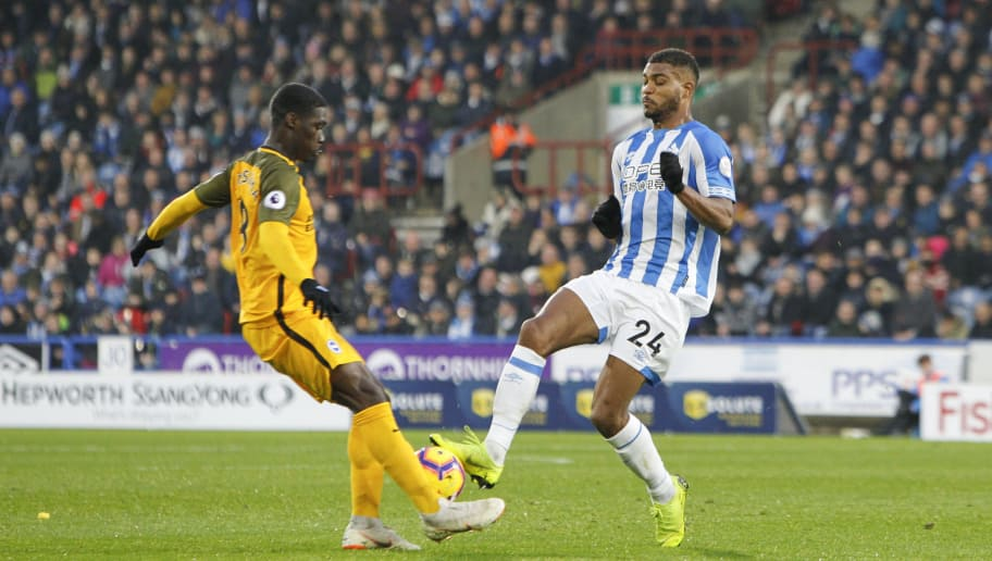 HUDDERSFIELD, ENGLAND - DECEMBER 01: Steve Mounié of Huddersfield Town challenges for the ball which leads to his sending off during the Premier League match between Huddersfield Town and Brighton & Hove Albion at John Smith's Stadium on December 1, 2018 in Huddersfield, United Kingdom. (Photo by Ben Early/Getty Images)