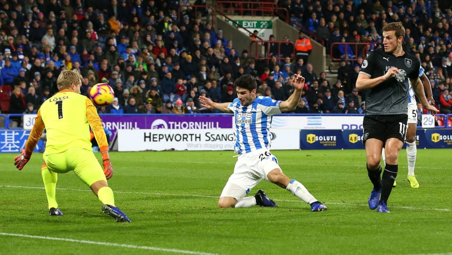HUDDERSFIELD, ENGLAND - JANUARY 02: Chris Wood of Burnley scores his sides first goal past Jonas Lossl of Huddersfield Town during the Premier League match between Huddersfield Town and Burnley FC at John Smith's Stadium on January 2, 2019 in Huddersfield, United Kingdom.  (Photo by Alex Livesey/Getty Images)