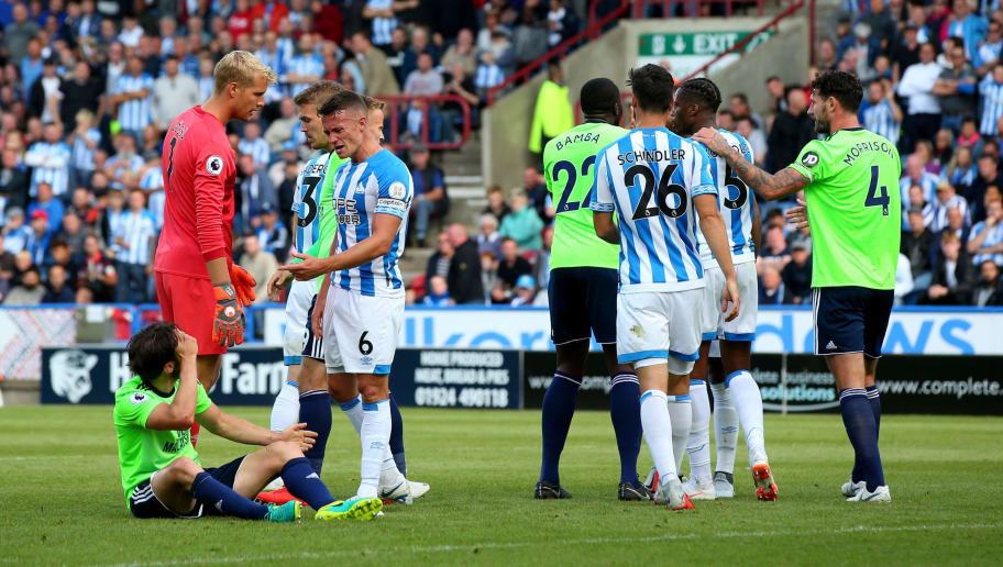 HUDDERSFIELD, ENGLAND - AUGUST 25:  Huddersfield Town and Cardiff City players speak following the Premier League match between Huddersfield Town and Cardiff City at John Smith's Stadium on August 25, 2018 in Huddersfield, United Kingdom.  (Photo by Alex Livesey/Getty Images)
