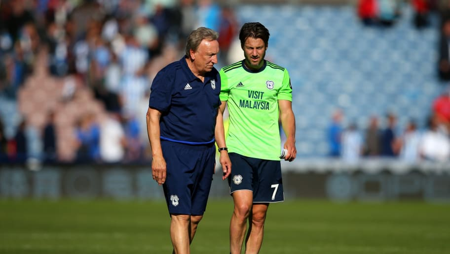 HUDDERSFIELD, ENGLAND - AUGUST 25:  Neil Warnock, Manager of Cardiff City speaks with Harry Arter of Cardiff City following the Premier League match between Huddersfield Town and Cardiff City at John Smith's Stadium on August 25, 2018 in Huddersfield, United Kingdom.  (Photo by Alex Livesey/Getty Images)