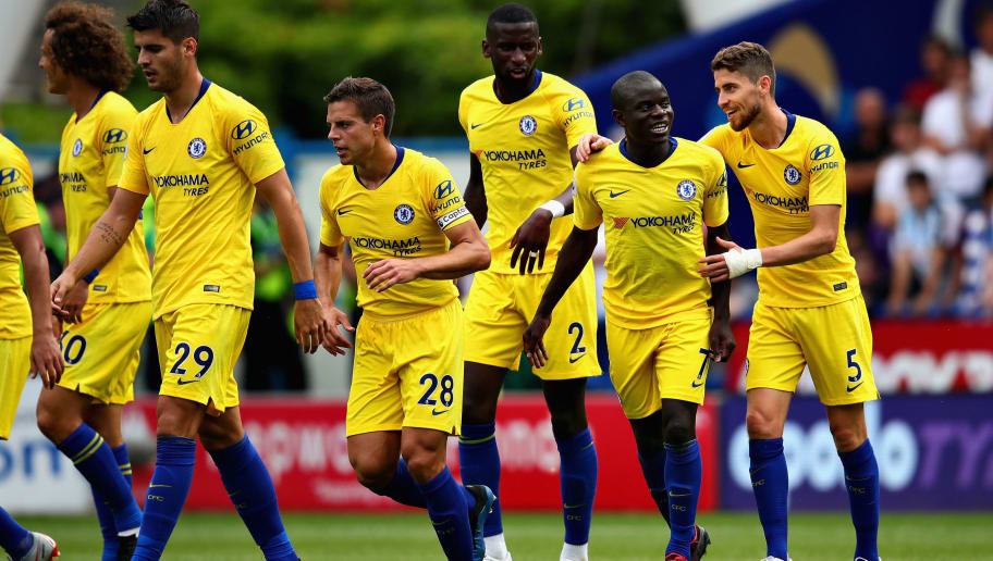 HUDDERSFIELD, ENGLAND - AUGUST 11: N'Golo Kante of Chelsea celebrates with his teammates after scoring his sides first goal during the Premier League match between Huddersfield Town and Chelsea FC at John Smith's Stadium on August 11, 2018 in Huddersfield, United Kingdom.  (Photo by Chris Brunskill/Fantasista/Getty Images)