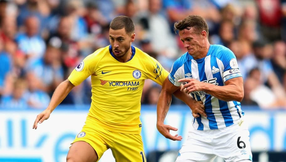 HUDDERSFIELD, ENGLAND - AUGUST 11:  Eden Hazard of Chelsea is challenged by Jonathan Hogg of Huddersfield Town during the Premier League match between Huddersfield Town and Chelsea FC at John Smith's Stadium on August 11, 2018 in Huddersfield, United Kingdom.  (Photo by Chris Brunskill/Fantasista/Getty Images)