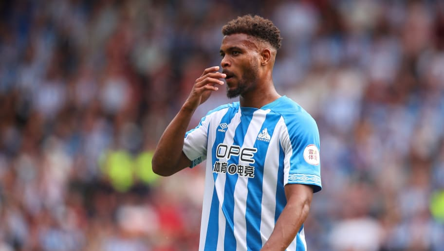 HUDDERSFIELD, ENGLAND - AUGUST 11: Steve Mounie of Huddersfield Town during the Premier League match between Huddersfield Town and Chelsea FC at John Smith's Stadium on August 11, 2018 in Huddersfield, United Kingdom. (Photo by Robbie Jay Barratt - AMA/Getty Images)