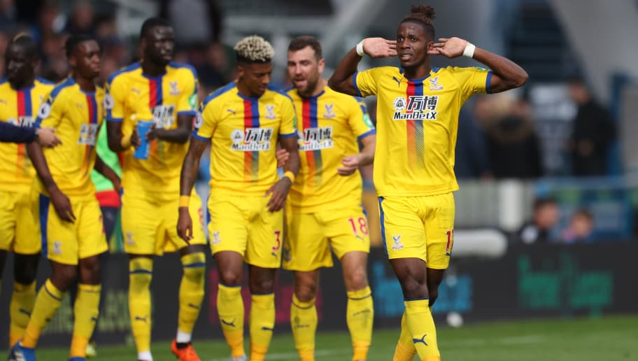 HUDDERSFIELD, ENGLAND - SEPTEMBER 15:  Wilfried Zaha of Crystal Palace celebrates after scoring his team's first goal during the Premier League match between Huddersfield Town and Crystal Palace at John Smith's Stadium on September 15, 2018 in Huddersfield, United Kingdom.  (Photo by Mark Robinson/Getty Images)