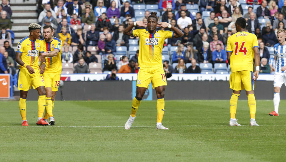 HUDDERSFIELD, ENGLAND - SEPTEMBER 15: Wifried Zaha of Crystal Palace celebrates scoring the winning goal  during the Premier League match between Huddersfield Town and Crystal Palace at John Smith's Stadium on September 15, 2018 in Huddersfield, United Kingdom. (Photo by John Early/Getty Images)