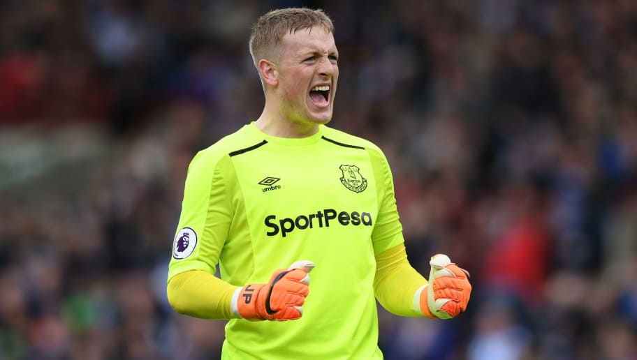 HUDDERSFIELD, ENGLAND - APRIL 28:  Jordan Pickford of Everton celebrates after his sides first goal during the Premier League match between Huddersfield Town and Everton at John Smith's Stadium on April 28, 2018 in Huddersfield, England.  (Photo by Shaun Botterill/Getty Images)