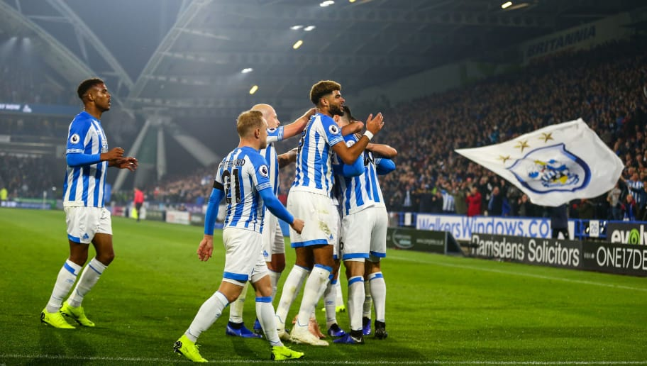 HUDDERSFIELD, ENGLAND - NOVEMBER 05: Christopher Schindler of Huddersfield Town celebrates after scoring a goal to make it 1-0  during the Premier League match between Huddersfield Town and Fulham FC at John Smith's Stadium on November 5, 2018 in Huddersfield, United Kingdom. (Photo by Robbie Jay Barratt - AMA/Getty Images)