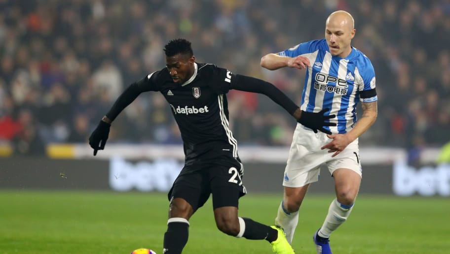 HUDDERSFIELD, ENGLAND - NOVEMBER 05:  Jean Michael Seri of Fulham is challanged by Aaron Mooy of Huddersfield Town during the Premier League match between Huddersfield Town and Fulham FC at John Smith's Stadium on November 5, 2018 in Huddersfield, United Kingdom.  (Photo by Matthew Lewis/Getty Images)