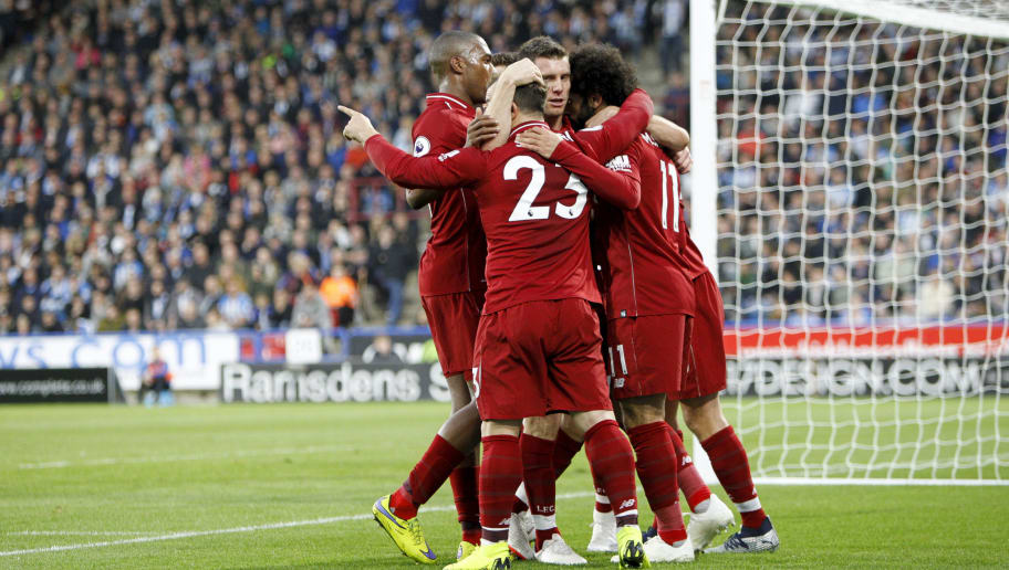 HUDDERSFIELD, ENGLAND - OCTOBER 20: Mohamed Salah of Liverpool FC celebrates with team mates during the Premier League match between Huddersfield Town and Liverpool FC at John Smith's Stadium on October 20, 2018 in Huddersfield, United Kingdom. (Photo by Ben Early/Getty Images)