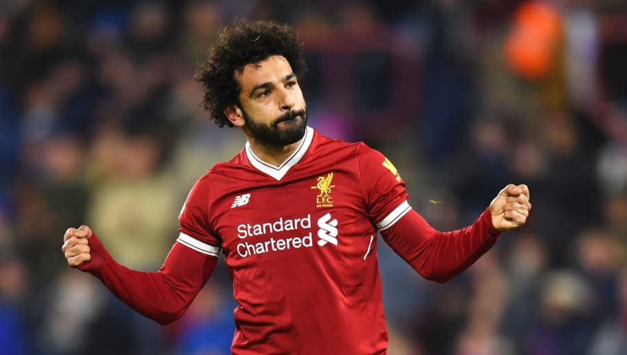 HUDDERSFIELD, ENGLAND - JANUARY 30:  Mohamed Salah of Liverpool celebrates as he scores their third goal from the penalty spot during the Premier League match between Huddersfield Town and Liverpool at John Smith's Stadium on January 30, 2018 in Huddersfield, England.  (Photo by Michael Regan/Getty Images)