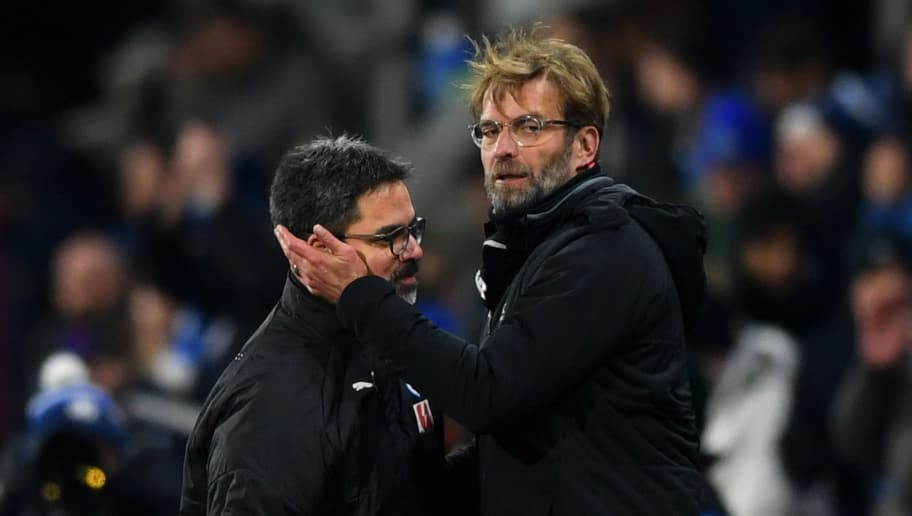 HUDDERSFIELD, ENGLAND - JANUARY 30:  Jurgen Klopp, Manager of Liverpool (R) and David Wagner, Manager of Huddersfield Town embrace after the Premier League match between Huddersfield Town and Liverpool at John Smith's Stadium on January 30, 2018 in Huddersfield, England.  (Photo by Gareth Copley/Getty Images)