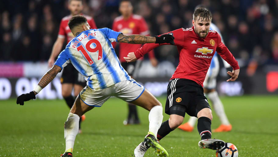 HUDDERSFIELD, ENGLAND - FEBRUARY 17:  Danny Williams of Huddersfield Town and Luke Shaw of Manchester United battle for the ball during the The Emirates FA Cup Fifth Round between Huddersfield Town v Manchester United on February 17, 2018 in Huddersfield, United Kingdom.  (Photo by Gareth Copley/Getty Images)