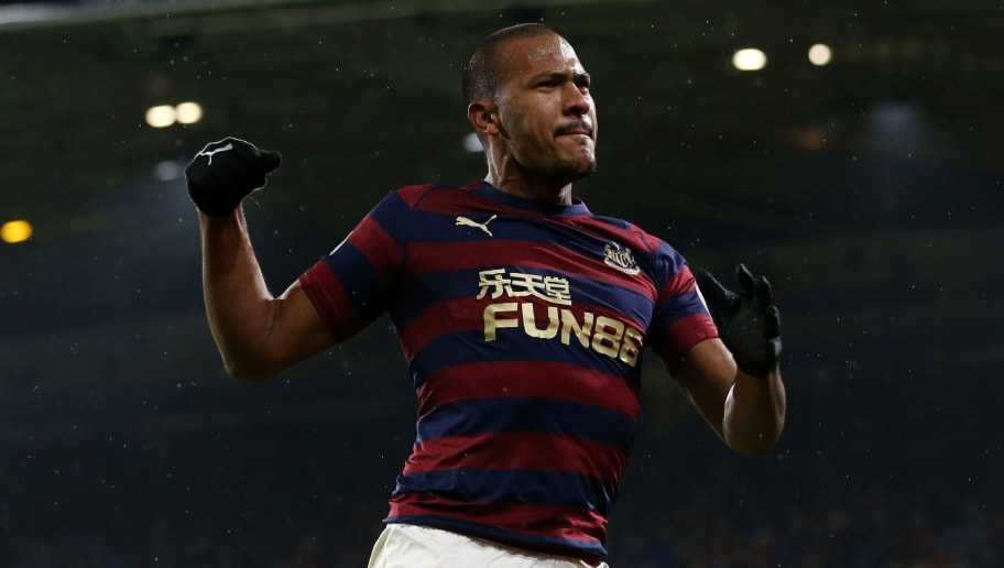 HUDDERSFIELD, ENGLAND - DECEMBER 15:  Salomon Rondon of Newcastle United celebrates after scoring his team's first goal during the Premier League match between Huddersfield Town and Newcastle United at John Smith's Stadium on December 15, 2018 in Huddersfield, United Kingdom.  (Photo by Jan Kruger/Getty Images)