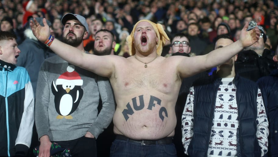 HUDDERSFIELD, ENGLAND - DECEMBER 15:  A Newcastle United fan shows their support during the Premier League match between Huddersfield Town and Newcastle United at John Smith's Stadium on December 15, 2018 in Huddersfield, United Kingdom.  (Photo by Jan Kruger/Getty Images)
