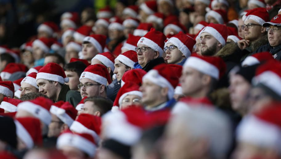 HUDDERSFIELD, ENGLAND - DECEMBER 22: Southampton fans wear christmas hats during the Premier League match between Huddersfield Town and Southampton FC at John Smith's Stadium on December 22, 2018 in Huddersfield, United Kingdom. (Photo by John Early/Getty Images)